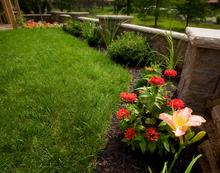 Allan Block Courtyard Wall With Landscaping Featuring Daylily, Iris, Boxwood, and Zinnia