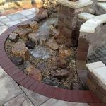 Pondless Waterfall - Featuring Clay Brick edging, Capella Stone, Bedford Wall Stone, and Rockcast Caps