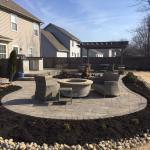 Boardwalk pavers surrounding precast firepit.